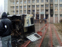 A-burned-out-police-car-near-the-administration-building-in-Talas-on-April-7