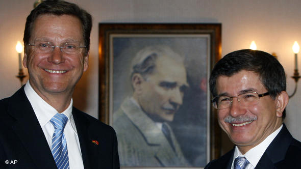 Ankara Foreign Minister Davatoglu (right, seen here with his German counterpart Guido Westerwelle) is reshaping Turkey's role in the world